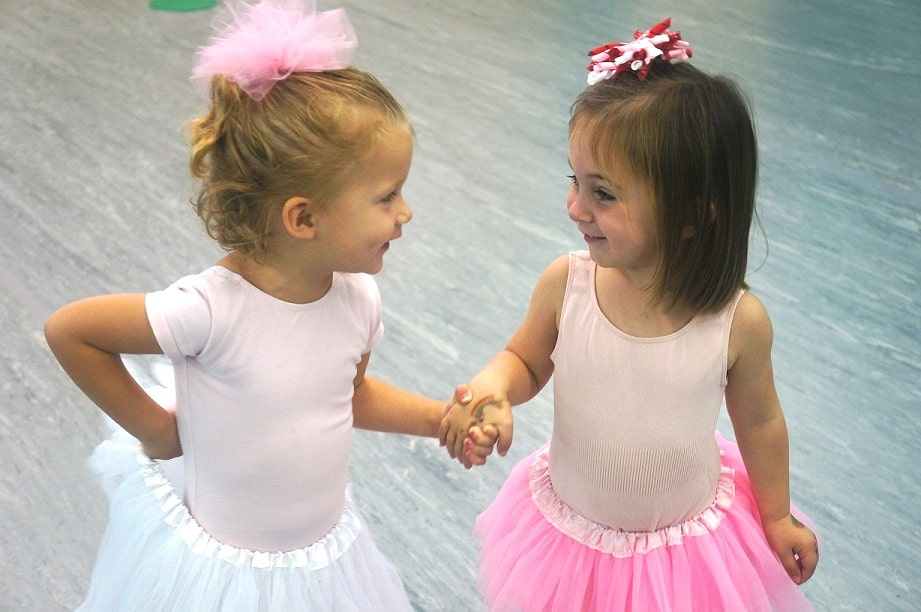 Two Young Dancers Holding hands